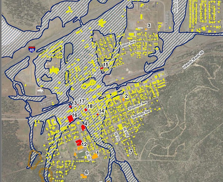 This map represents possible areas that could be impacted by flood waters following a catastrophic fire on Bill Williams Mountain. The blue areas are the areas expected to be inundated, the yellow are current buildings in Williams. The red represents critical facilities such as schools, government offices and utilities that could be affected. (JE Fuller graphic)