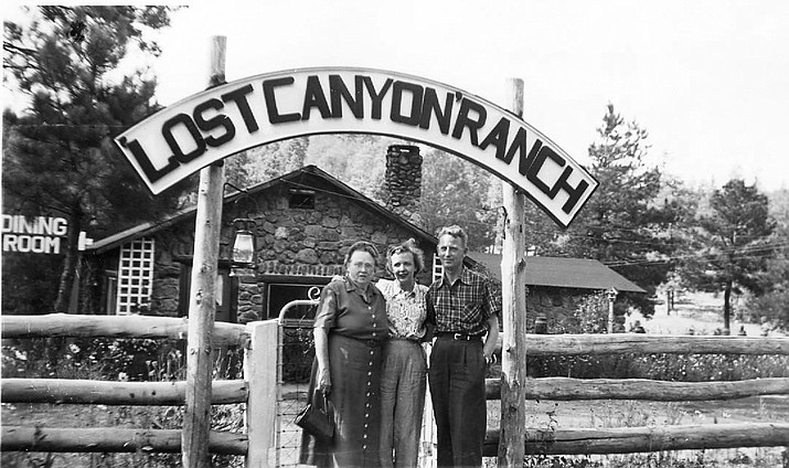 Ann Terry and two unknown people stand at the entrance to the Lost Canyon Camp. The camp is located in a small valley south of Williams. (Williams Historic Photo Archives)