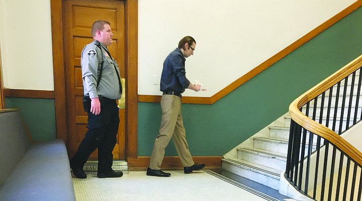 Buddy O'Brian Wallace leaves the restroom at Mohave County Superior Court during a break Wednesday in his first-degree murder trial. (Photo by Hubble Ray Smith/Daily Miner)
