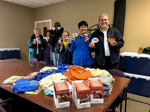 Ron Sharpe, Executive Director of Arc of the Bay in Florida, stands with Arc of the Bay guys and gals, showing off the contents of the post-Hurricane Michael care package they received from the guys and gals at YEI! in Prescott. (Courtesy)