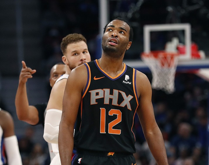 Phoenix Suns forward T.J. Warren (12) looks toward the scoreboard after a second technical foul during the first half of an NBA basketball game against the Detroit Pistons, Sunday, Nov. 25, 2018, in Detroit. Warren fouled out of the game. (Carlos Osorio/AP)