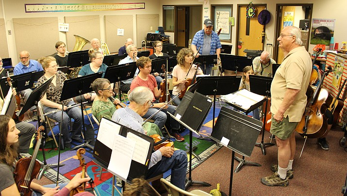 Members of the Mohave Community Orchestra practice in April. The orchestra and Mohave Community Choir are holding its Christmas Concert set for 3 p.m. Saturday at the Kingman High School auditorium, 4182 N. Bank St.