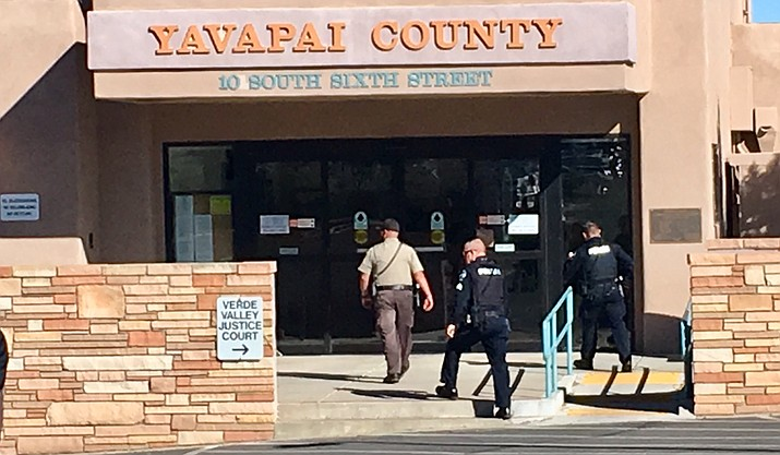 Cottonwood police and other area emergency responders evacuate the Yavapai County Annex in Cottonwood shortly after noon today following a report of a bomb in the assessor's office. VVN/Vyto Starinskas