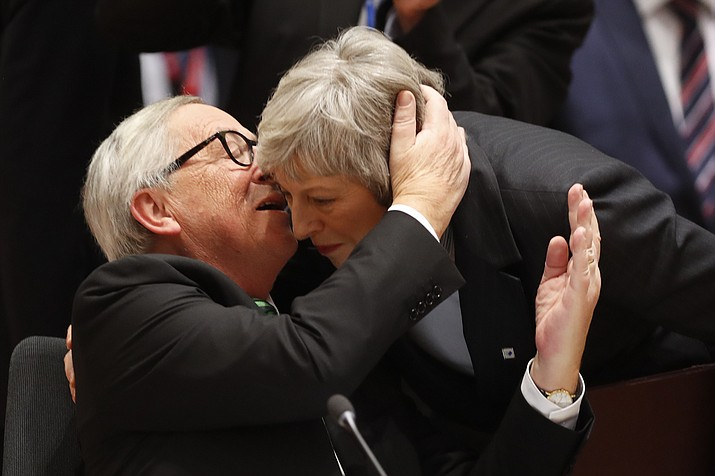 European Commission President Jean-Claude Juncker, left, greets British Prime Minister Theresa May during a round table meeting at an EU summit in Brussels, Thursday, Dec. 13, 2018. EU leaders gathered Thursday for a two-day summit which will center on the Brexit negotiations. (Alastair Grant/AP)