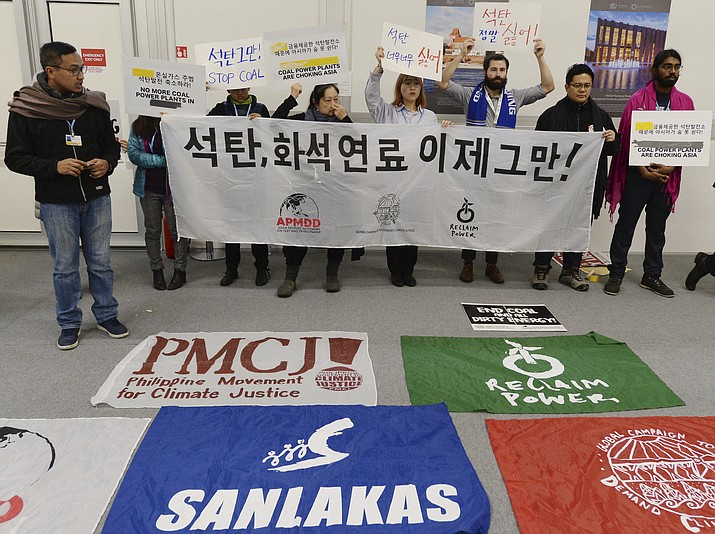 Young people protest in the main hall at the COP24 summit in Katowice, Poland, Thursday, Dec. 13, 2018.(Czarek Sokolowski/AP)