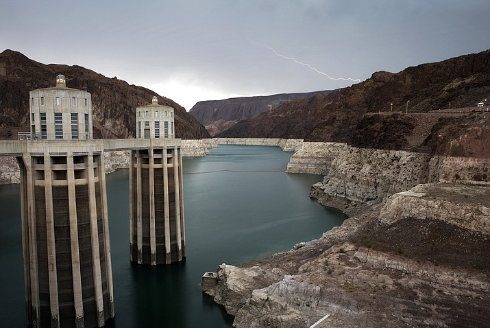 In this July 28, 2014, file photo, lightning strikes over Lake Mead near Hoover Dam that impounds Colorado River water at the Lake Mead National Recreation Area in Arizona. With drought continuing and reservoirs shrinking, several Southwestern U.S. states that depend on the Colorado River had been expected to ink a crucial share-the-pain contingency plan by the end of 2018. Officials now say they're not going to make it, at least not in time for upcoming meetings in Las Vegas involving representatives from Arizona, California, Colorado, Nevada, New Mexico, Utah, Wyoming and the U.S. government. (AP Photo/John Locher, File)