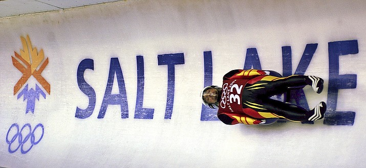 In this Feb. 9, 2002, file photo, Georg Hackl, of Germany, speeds past an Olympic logo during a practice run for the men's singles luge at the 2002 Salt Lake City Winter Olympics in Park City, Utah.  (AP Photo/Elise Amendola, File)