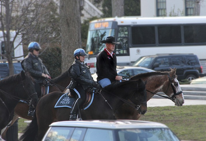 In this photo provided by the Interior Department shows Interior Secretary Ryan Zinke arriving for his first day of work at the Interior Department in Washington, Thursday, March 2, 2017, aboard Tonto, an 17-year-old Irish sport horse. Zinke will be leaving the administration at the end of 2018, Trump said Saturday, Dec. 15. (Interior Department via AP)
