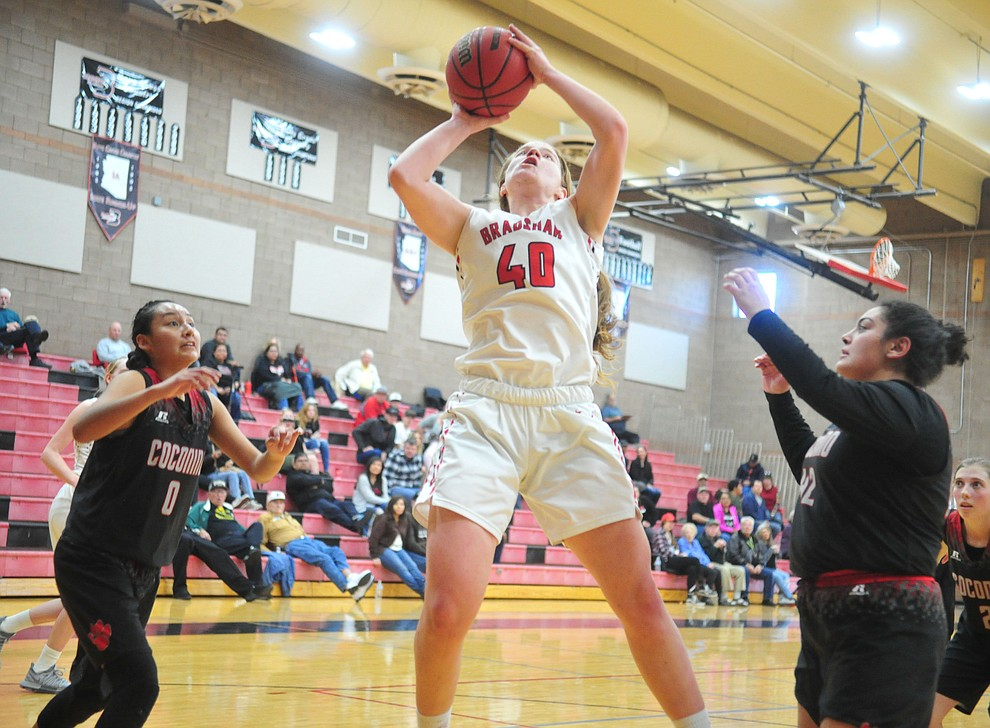Bradshaw Mountain's Delanie Clark goes up between defenders as the Bears hosted Coconino in a doubleheader hoops matchup Saturday, Dec. 15, 2018 in Prescott Valley. (Les Stukenberg/Courier).