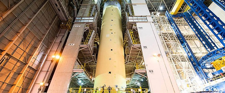 This photo released by NASA, shows the 149-foot long tank which is part of the Space Launch System in Florida. NASA is moving a massive liquid hydrogen tank to Huntsville, Ala., for testing as part of its plans to eventually return to the moon. (Jude Guidry/NASA via AP)