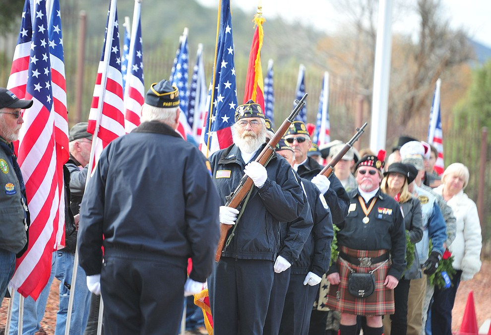American Legion Post 6 Honor Guard presents the colors during the Wreaths Across America  ceremony that placed 2106 veteran remembrance wreaths at the Prescott National Cemetery Saturday, Dec. 15, 2018. (Les Stukenberg/Courier).