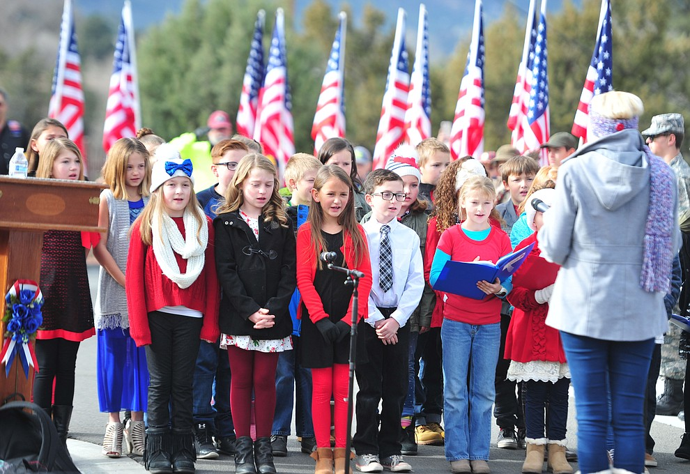 The Granville Elelmentary School choir sings the National Anthem during the Wreaths Across America ceremony where 2106 veteran remembrance wreaths at the Prescott National Cemetery Saturday, Dec. 15, 2018. (Les Stukenberg/Courier).