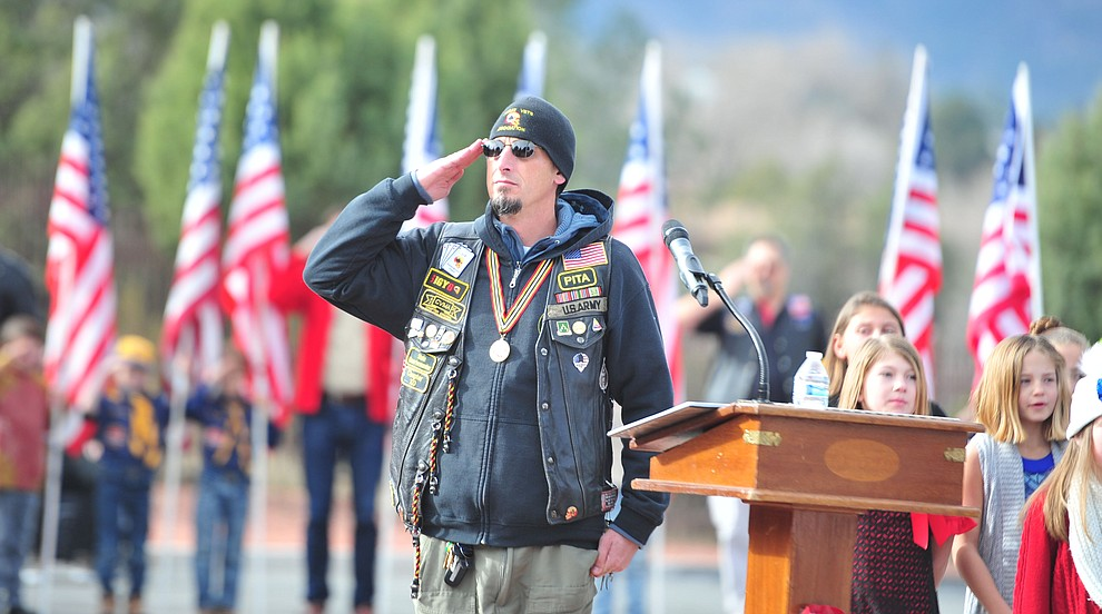 Darren Driggs salutes during the National Anthem during the Wreaths Across America ceremony where 2106 veteran remembrance wreaths at the Prescott National Cemetery Saturday, Dec. 15, 2018. (Les Stukenberg/Courier).