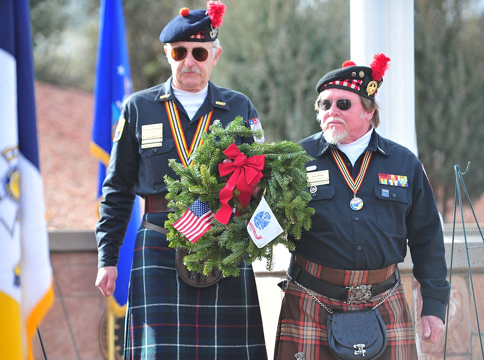 Scottish AMerican Military Society Post 1297 place a ceremonial wreath during the Wreaths Across America ceremony where 2106 veteran remembrance wreaths at the Prescott National Cemetery Saturday, Dec. 15, 2018. (Les Stukenberg/Courier).