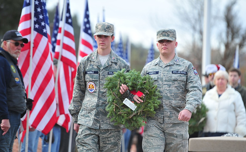 Civil Air Patrol cadets Darrel Paul Bellows Roberts and Carson Gamble place a wreath to honor those that served or are serving in the United States Air Force during the Wreaths Across America ceremony where 2106 veteran remembrance wreaths at the Prescott National Cemetery Saturday, Dec. 15, 2018. (Les Stukenberg/Courier).