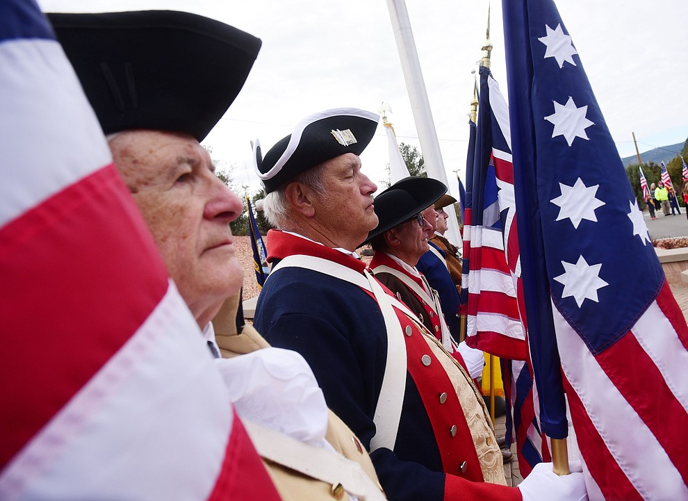 Prescott Sons of the American Revolution stand at attention during the Wreaths Across America ceremony where 2106 veteran remembrance wreaths at the Prescott National Cemetery Saturday, Dec. 15, 2018. (Les Stukenberg/Courier).