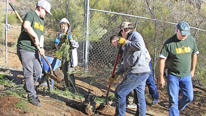 Photo Feature: Local Troop 7020 Boy Scouts work to create a path around Sunset Lake