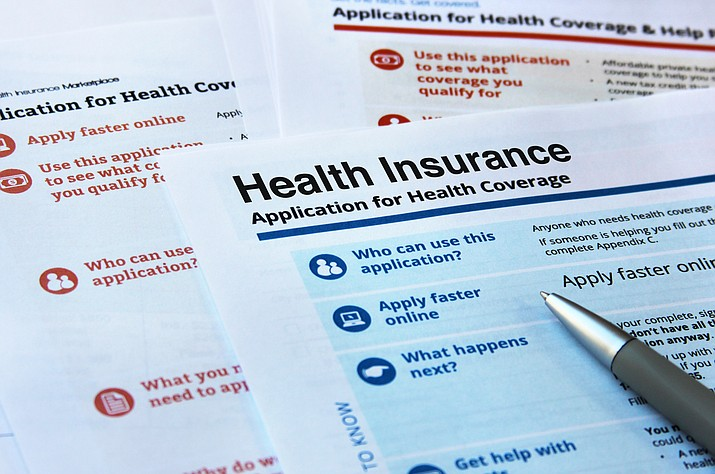 "A conservative federal judge in Texas on Friday ruled the Affordable Care Act ""invalid"" on the eve of the sign-up deadline for next year. But with appeals certain, even the Trump White House said the law will remain in place for now. (Adobe Image)"