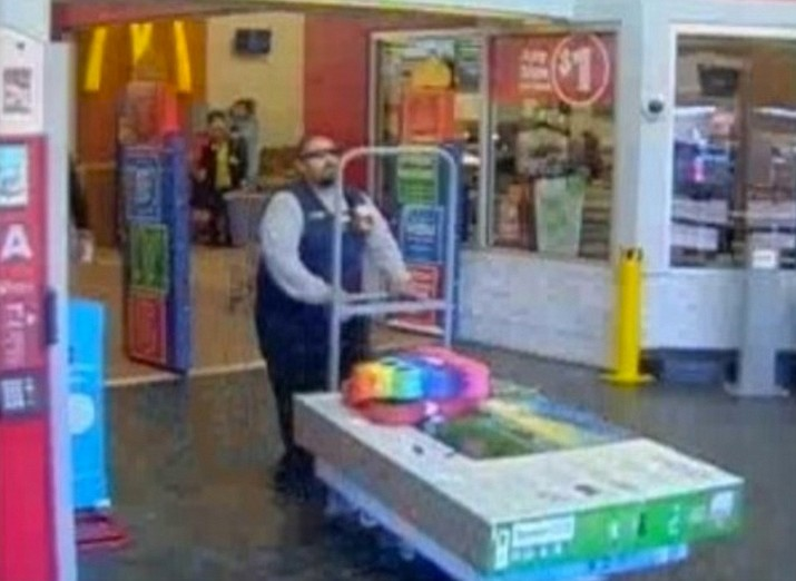 On November 24 this man walked into an Albuquerque Walmart dressed as a store employee. He entered an employee-only area and took a six-wheeler cart, which he loaded with two televisions and two pinatas and then walked out of the store without paying. (Albuquerque Police Department)