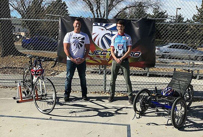 Prescott Project Hero Hub leader Sean Hankison (left) with Project Hero Communications Director Jason Olig and bikes donated to Project Hero, a regular road bike and an adaptive one. (Courtesy)