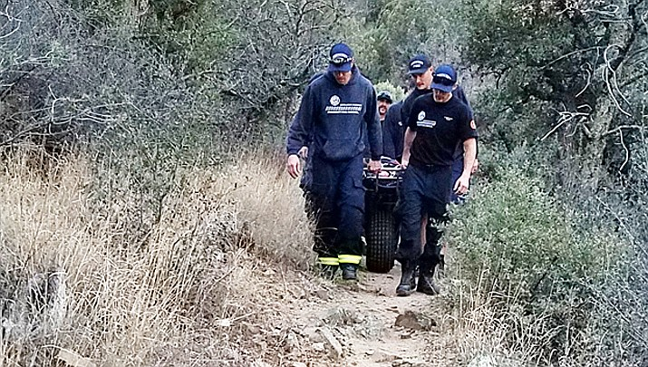 Prescott Fire Department personnel carry a woman using a Stokes basket along Salida Gulch trail near Lynx Lake Sunday, Dec. 16.