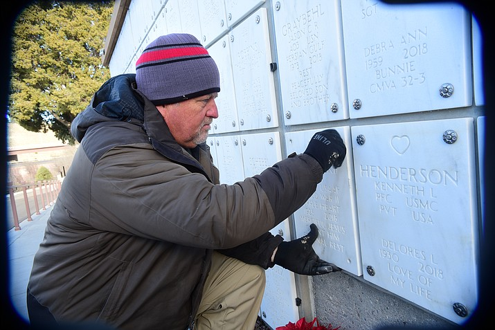Caretaker Jim Darst installs a new niche cover at the Prescott National Cemetery Tuesday, Dec. 11, 2018. (Les Stukenberg/Courier)