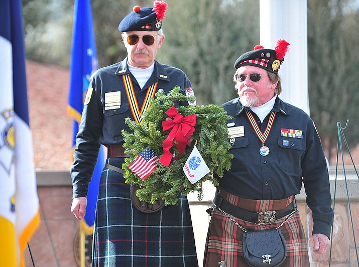 Members of Scottish American Military Society Post 1297 place a ceremonial wreath during the Wreaths Across America ceremony Saturday, Dec. 15, 2018, as 2,106 veteran remembrance wreaths were placed at the Prescott National Cemetery. (Les Stukenberg/Courier)