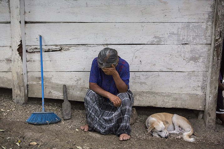 Elvira Choc, 59, Jakelin Amei Rosmery Caal's grandmother, rests her head on her hand in front of her house in Raxruha, Guatemala, on Saturday, Dec. 15, 2018. The 7-year old girl died in a Texas hospital, two days after being taken into custody by border patrol agents in a remote stretch of New Mexico desert. (Oliver de Ros/AP)