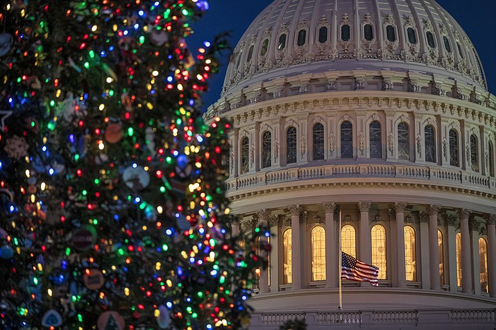 The Capitol is seen at twilight in Washington, Monday, Dec. 17, 2018. The fight over President Donald Trump's $5 billion wall funds deepened Monday, threatening a partial government shutdown in a standoff that has become increasingly common in Washington. (J. Scott Applewhite/AP)