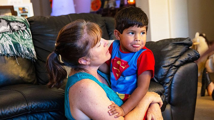 Mimi Condon attempts to calm her energetic son, Isaac. In addition to her role as a stay-at-home mom, she volunteers as a court-appointed special advocate, advocating for kids still in foster care. (Photo by Lindsay Walker/Special to Cronkite News)