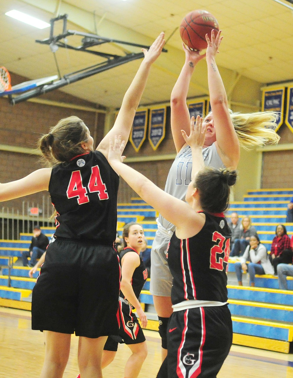 Embry Riddle's Katana Martina goes up over a double team as the Eagles hosted the Grace Lancers Tuesday, Dec. 18, 2018 in Prescott. (Les Stukenberg/Courier).