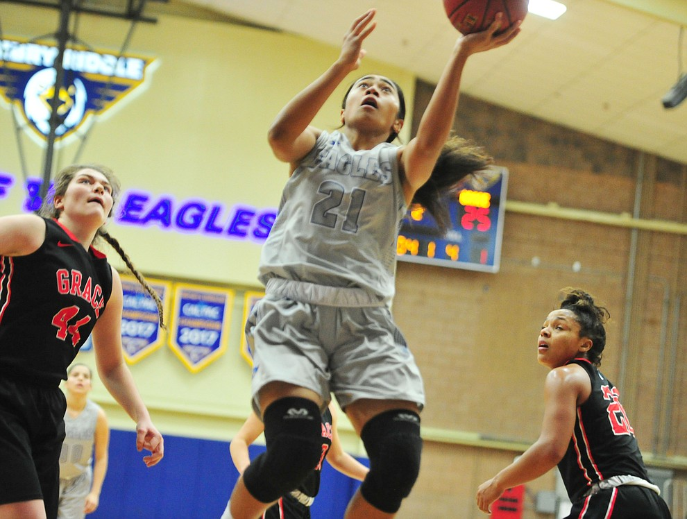 Embry Riddle's Jazlyn Maletino splits defenders as the Eagles hosted the Grace Lancers Tuesday, Dec. 18, 2018 in Prescott. (Les Stukenberg/Courier).
