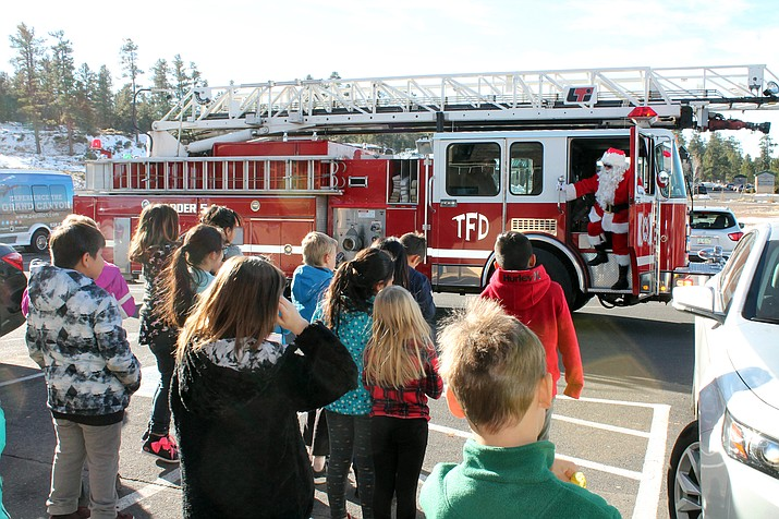 A Grand Canyon elementary students shares a laugh and his Christmas list with Santa at the Tusayan McDonald's Dec. 5. (Erin Ford/WGCN)