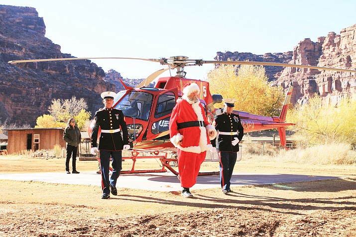 Santa Claus flanked by two U.S. Marines arrives at Supai Village in the bottom of the Grand Canyon Dec. 12. (Loretta Yerian/WGCN)