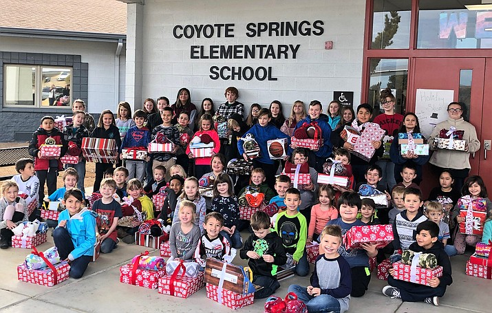 Student Council members at Coyote Springs Elementary School help fill empty shoeboxes Dec. 14 with school supplies, hygiene articles, gloves, scarves and toys for 90 students at their school. (Coyote Springs Elementary School/Courtesy)
