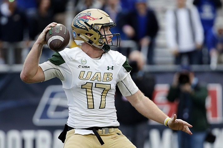 UAB quarterback Tyler Johnston III looks to pass against Middle Tennessee in the second half of the NCAA Conference USA championship college football game Saturday, Dec. 1, 2018, in Murfreesboro, Tenn. (Mark Humphrey/AP)