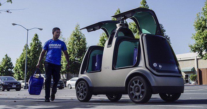 This undated image provided by The Kroger Co. shows an autonomous vehicle called the R1. Nuro and grocery chain Kroger are teaming up to bring unmanned delivery service to customers. The companies said Tuesday, Dec. 18, 2018, that Nuro's unmanned vehicle, the R1, will be added to a fleet of autonomous Prius vehicles that have run self-driving grocery delivery service in Scottsdale, Ariz., with vehicle operators since August. (Andrew Brown/The Kroger Co. via AP)