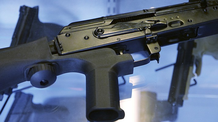 "A device called a ""bump stock"" is attached to a semi-automatic rifle Oct. 4, 2017, at the Gun Vault store and shooting range in South Jordan, Utah. (Rick Bowmer/AP)"