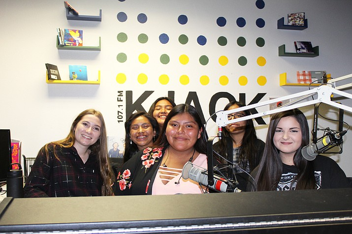 Hopi High media students get tips from KJAC disc jockeys at Northern Arizona University. From left: Kimmale Anderson, Katrese Lomayaktewa and Cierra Brady and Aubrey Harvey sit at the booth. (Stan Bindell/NHO)