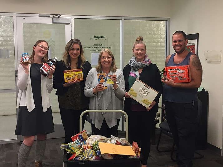 YC faculty, staff and students display some of the nearly 421 items collected during a friendly competition benefiting an emergency food pantry for students. (Courtesy)