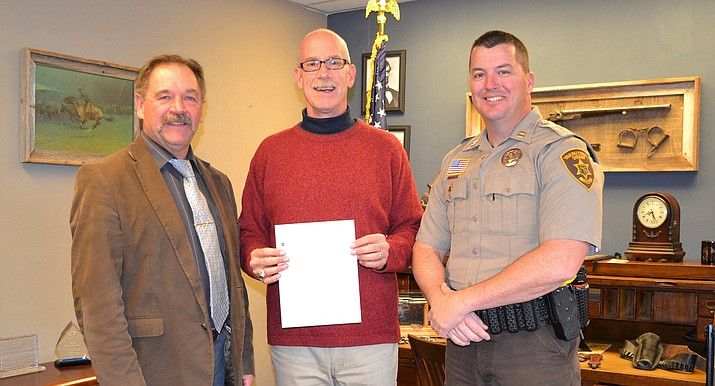Yavapai County Sheriff Scott Mascher, U.S. Vets Development and Communications Manager in Prescott Matthew Phillips, and Yavapai County Sheriff's Office Capt. Jeff Newnum, a veteran and current Detention Services Commander, pose for a photo after the Sheriff's Office donated $3,615 to U.S. Vets following No Shave November. (Yavapai County Sheriff's Office/Courtesy)