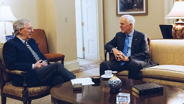 Senators Mitch McConnell, left, and John Cornyn talk politics. Congress and President Donald Trump continue to bicker over his demand that lawmakers fund a wall along the U.S.-Mexico border, pushing the government to the brink of a partial shutdown at midnight Friday. (Photo from Mitch McConnell)