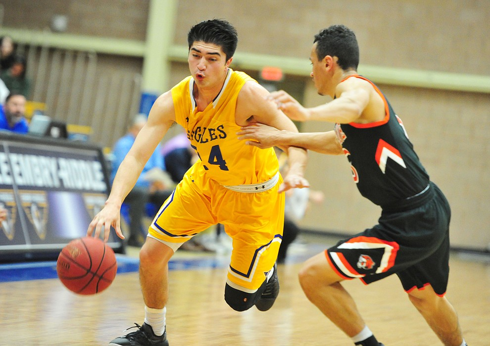 Embry Riddle's Gilbert Ibarra drives past a defender as the Eagles face the Doane Tigers Thursday, Dec. 20, 2018 in Prescott. (Les Stukenberg/Courier).