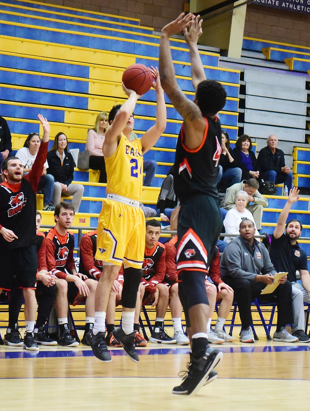 Embry Riddle's Gilbert Ibarra takes a three-point shot as the Eagles face the Doane Tigers Thursday, Dec. 20, 2018 in Prescott. (Les Stukenberg/Courier).