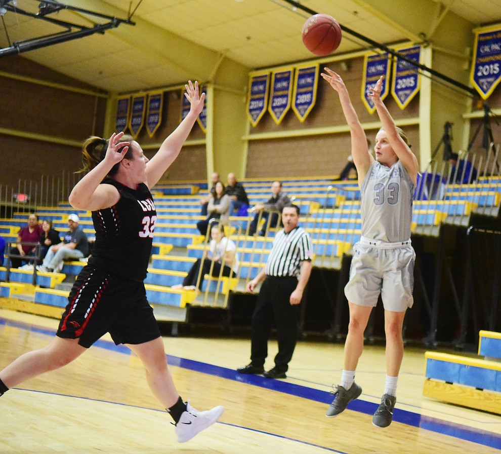 Embry Riddle's Jenna Knudson takes a three-point shot as the Eagles face the Lincoln Christian Red Lions Thursday, Dec. 20, 2018 in Prescott. (Les Stukenberg/Courier).