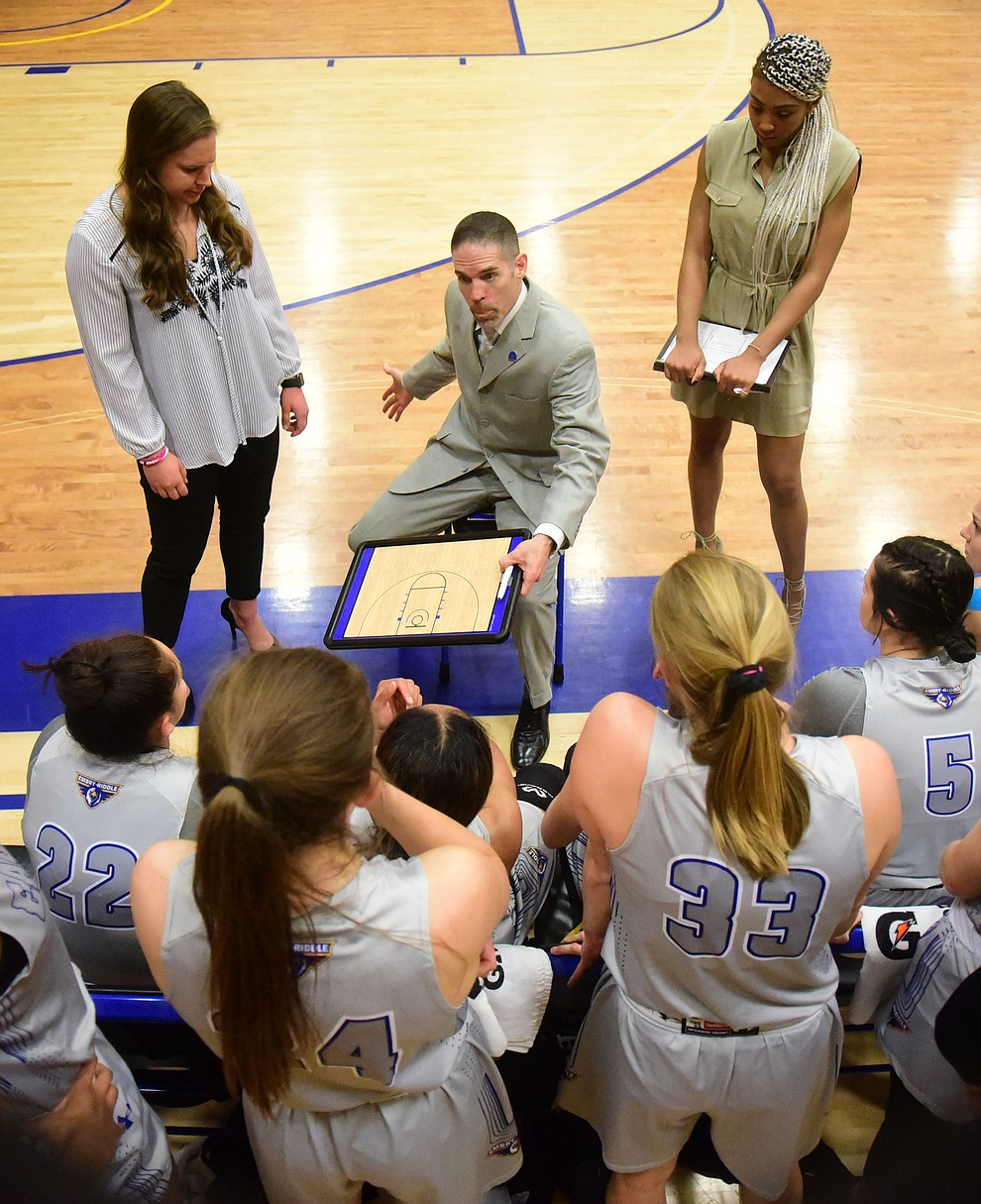 Embry Riddle Head Coach Mike Trujillo talks to players during a timeout as the Eagles face the Lincoln Christian Red Lions Thursday, Dec. 20, 2018 in Prescott. (Les Stukenberg/Courier).