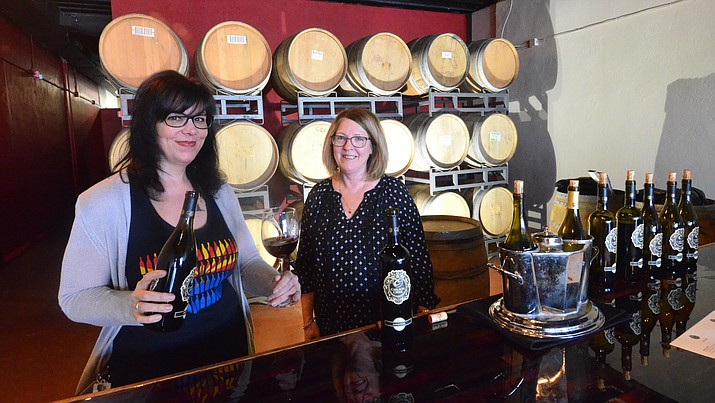 Michelle Carroll pours wine at the Carlson Creek Vineyard tasting room in Cottonwood. VVN/Vyto Starinskas
