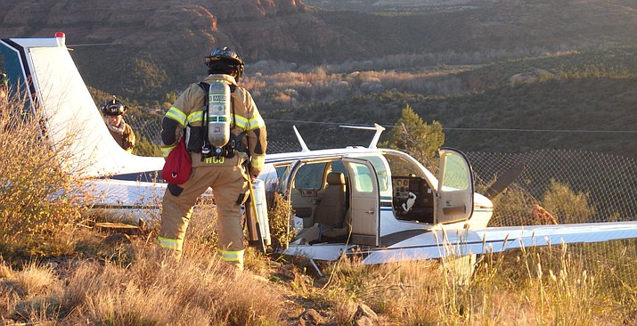 None of the three occupants of this Beechcraft Bonanza A36 were injured in the Wednesday crash and declined transport for medical evaluation. Initial reports indicate that a door or compartment on the aircraft had come open when the plane took off. The pilot was attempting to return to the airport and land when the aircraft overshot the runway and crashed. Photos courtesy of Sedona Fire District