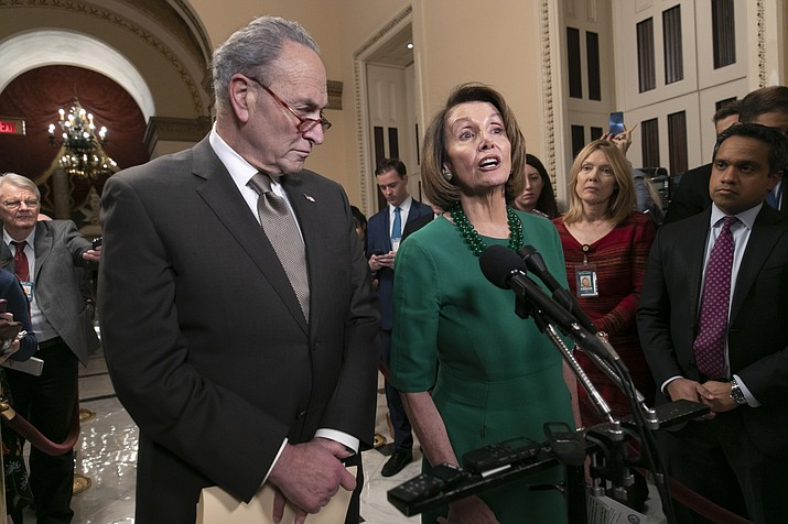 Senate Minority Leader Chuck Schumer, D-N.Y., and House Democratic Leader Nancy Pelosi of California, the speaker-designate for the new Congress, talk to reporters as a revised spending bill is introduced in the House that includes $5 billion demanded by President Donald Trump for a wall along the U.S.-Mexico border, as Congress tries to avert a partial shutdown, in Washington, Thursday, Dec. 20, 2018. (AP Photo/J. Scott Applewhite)
