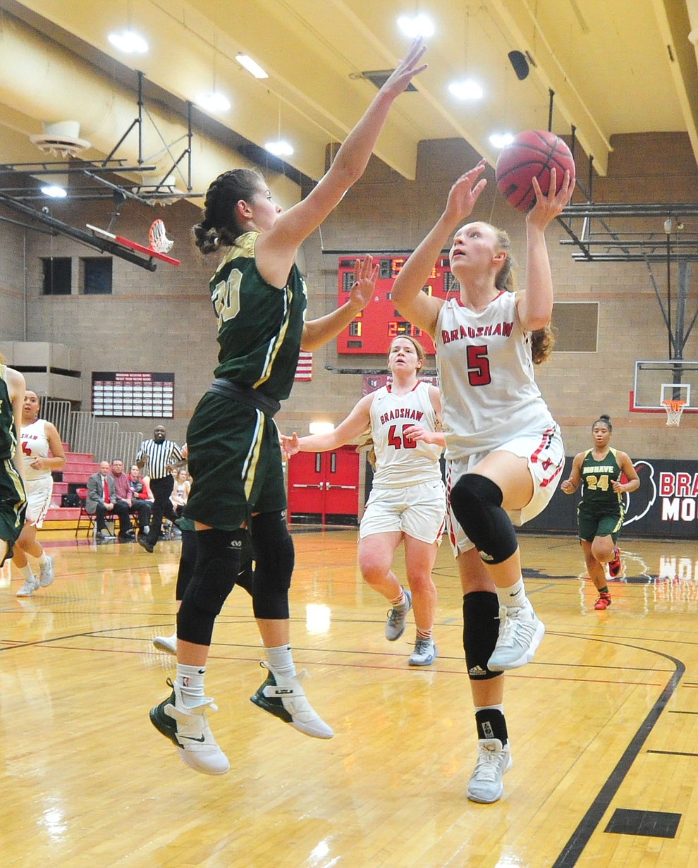 Bradshaw Mountain's Sierra Woolley drives through the lane as the Bears host the Mohave Thunderbirds in a basketball matchup Friday night in Prescott Valley. (Les Stukenberg/Courier).